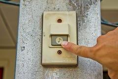 Pushing an electronic doorbell Stock Photos