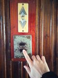 Pushing elevator button Stock Photos