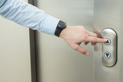 Pushing elevator up button Royalty Free Stock Photography