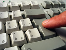 Pushing the enter button. Index finger pushing the enter button Stock Image