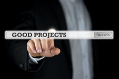 Pushing Good projects  search bar. Businessman pushing Good projects  search bar on a virtual computer screen or interface Stock Photo