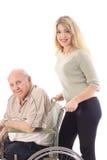Pushing Grandpa. Shot of Grand daughter Pushing Grandpa Royalty Free Stock Photography