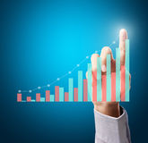 Pushing the graph Stock Photo