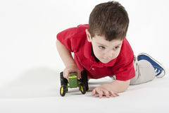 Free Pushing His Toy Tractor Stock Photos - 9411553