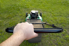 Pushing the Lawn Mower Royalty Free Stock Photo