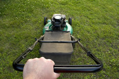 Pushing the Lawn Mower Stock Photography
