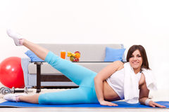 Pushing legs up, fitness at home Stock Images