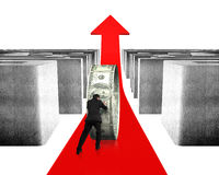 Pushing money circle on red arrow with maze Royalty Free Stock Photo