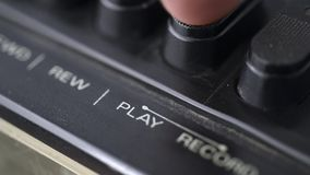 Pushing play button. Of vintage cassette deck stock video footage