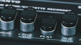Pushing play button on a vintage tape recorder. Close-up. Pushing a Finger Button Play. Man finger presses playback control buttons on audio cassette player stock video footage