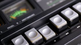 Pushing Play Button on a Vintage Tape Recorder. Transistor retro radio. Pushing Play Button on a Vintage Tape Recorder. Close-up. Pushing a Finger Button Play stock footage