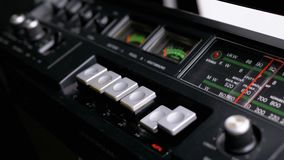 Pushing play, stop, rec, ff, rew buttons on a tape recorder. Buttons on transistor retro radio. Close-up. male finger pushes playback control buttons on audio stock video