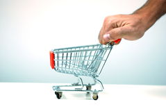 Pushing a shopping cart Royalty Free Stock Photos