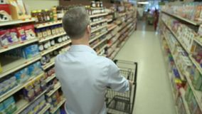 Pushing a shopping cart in a grocery store (4 of 4)