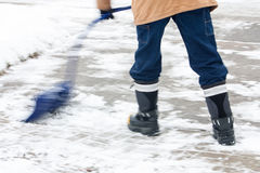 Pushing the snow with curved snow shovel Royalty Free Stock Images