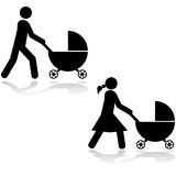Pushing a stroller Stock Image