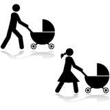 Pushing a stroller Stock Image