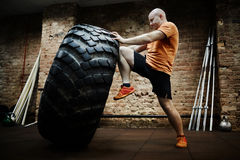 Pushing tire Royalty Free Stock Photography
