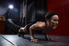 Pushing up in gym Stock Photos