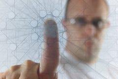 Pushing through the web. Man pushing finger through the web Royalty Free Stock Image