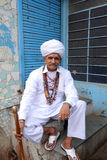 Pushkar Raj Portrait. An Indian gentleman from Pushkar, Rajasthan dressed in traditional dress with many mala necklaces and an intricate forehead tilaka Stock Images