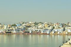 Pushkar festival by lake. Scenic view of people celebrating festival by lake in Pushkar, Rajasthan, India Stock Photography