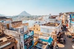 Pushkar lake and old market street in India royalty free stock image