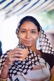PUSHKAR, INDIA - JAN 16, 2017 Woman Drinking Masala Tea On The S Royalty Free Stock Image