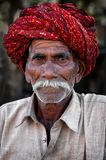 PUSHKAR, INDIA - MARCH 03, 2013: Undefined man with moustache in colourful turban portrait Stock Image