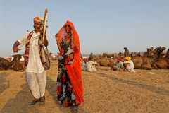 Two musicians during the festival in Pushkar. PUSHKAR, INDIA, October 28, 2017 : Musicians during the festival. Pushkar Camel fair is one of the largest cattle stock photography