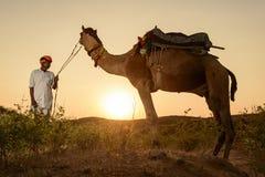 Pushkar kamelaffärsman Arkivbild