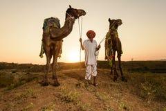 Pushkar kamelaffärsman Arkivfoton