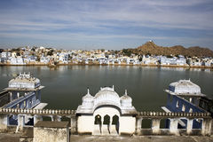 Pushkar Lake. Pushkar is pilgrim site in India.  It attracts pilgrims, babas, snake charmers and many backpackers.  It's a considered a very scared place by Royalty Free Stock Photo