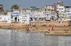 Pushkar lake with hindu people descend to bathe in sacred waters Royalty Free Stock Image