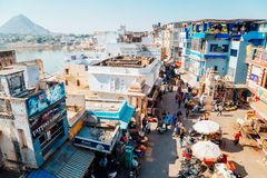 Pushkar lake and old market street in India. Pushkar, India - December 8, 2017 : Pushkar lake and old market street stock image