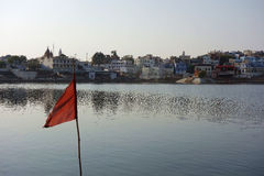 Pushkar Lake with a Red Flag Stock Image