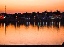 Pushkar at night, Rajasthan, India. The night view over the Pushkar Lake and the candle lighting ceremony Stock Photos
