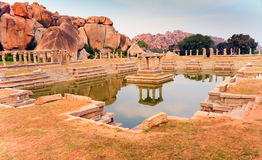 The pushkarni, a temple pond at Hampi. The temple pond of the Achutaraya temple at Hampi, in Karnataka, India. Part of the temple ruins built in the 14th century royalty free stock photography