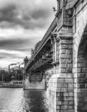 Pushkin Bridge across the Moscow River. A view of the Frunzenskaya embankment from the side of Gorky Park. Embankment of the Moskva River. Black and white Stock Photography