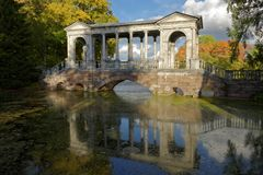 Marble bridge in Catherine`s park, St. Petersburg, Russia. Pushkin, St. Petersburg, Russia - September 20, 2015: Marble bridge in Catherine park. Also known as Stock Photo