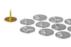 Pushpin. Golden pushpin at the head troop of iron pushpin Stock Photos