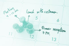 Pushpin on calendar with busy day. Royalty Free Stock Images