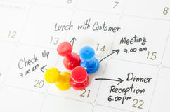 Pushpin on calendar with busy day. Royalty Free Stock Photography