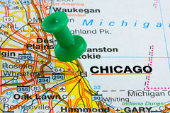 Pushpin in Chicago Map. City of Chicago highlighted with a green push pin on an atlas or map Stock Image