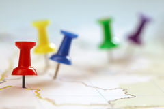 Pushpin on map. Travel destination points on a map indicated with colorful thumbtacks and shallow depth of field with space for copy Stock Photography