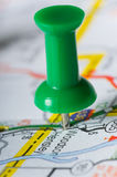 Pushpin on Map. Pinpointng a particular area, map in not distinguishable Stock Images