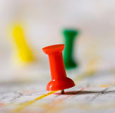 Pushpin on Map. Pinpointng a particular area, map in not distinguishable Royalty Free Stock Image