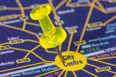 Pushpin on the map showing city center. Yellow pushpin on the map showing city center location Royalty Free Stock Photos