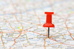 Pushpin marking location on map Stock Images