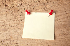 Pushpin notepad on board. Empty or blank notepad on a vintage wooden board Royalty Free Stock Photos